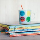 childrens booked stacked with sippy cup on top